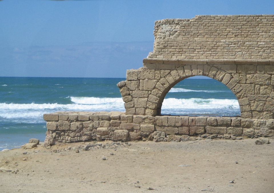 The ruins of an old aqueduct by the Mediterranean Sea